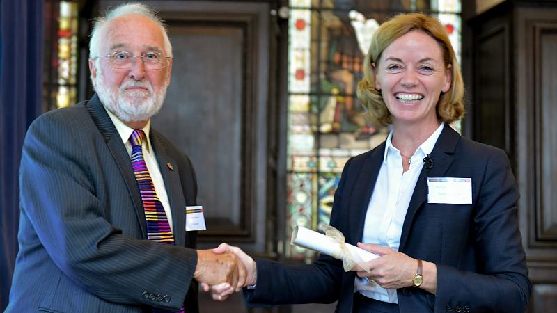 Professor Dorothy Kenny receiving an Honorary Fellowship from Dr Nicholas Bowen, CIOL President