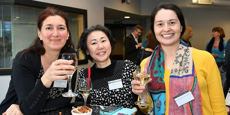 Members networking over a glass of wine